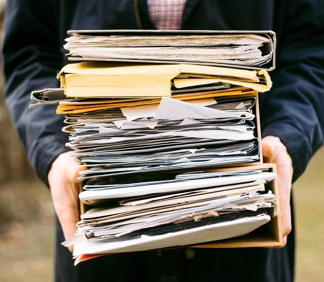 person holding folders